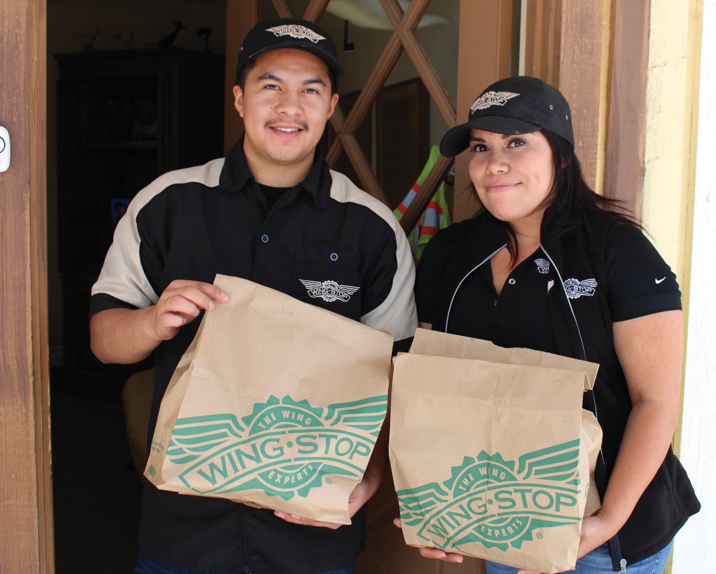"""The newest restaurant in town, Wingstop, made a visit at the Times-Advocate office on Tuesday with six different kinds of tasty wings, along with some sides. They ranged from """"atomic"""" to traditional to sweet and sour and Parmesan flavored. Tanya Guerrero, general manager of the new Wingstop and her assistant, Andy Saldivar, delivered the wings. The Times-Advocate staff dug in and, after munching on about ten pieces apiece were far too heavy to fly away any time soon. Wingstop is located at 1815 E. Valley Parkway."""