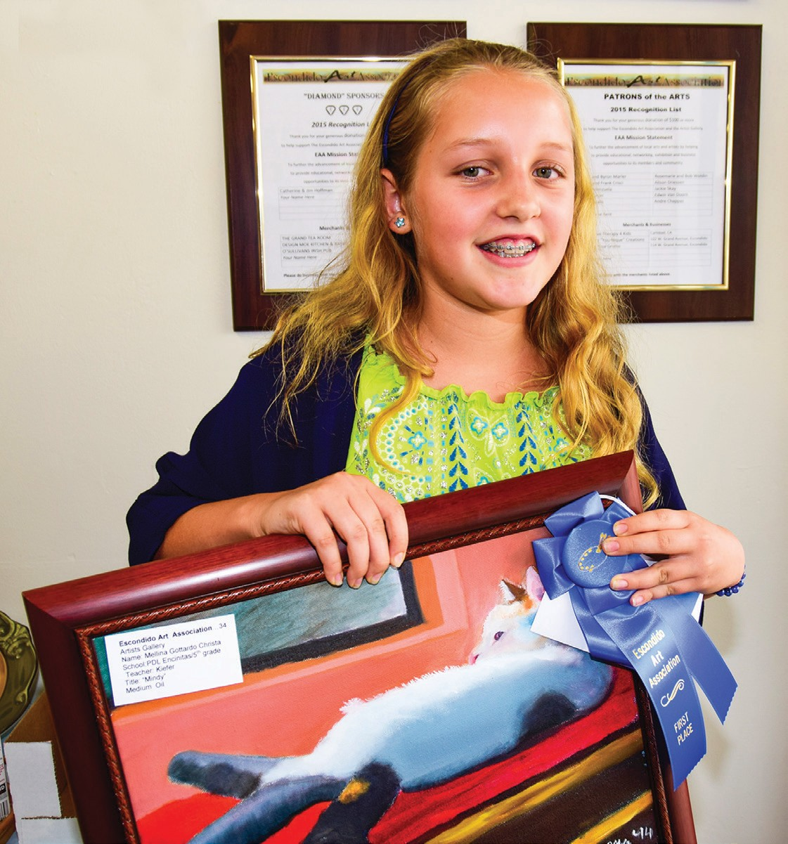 Christa Mellina-Gottardo and her Middle School 1st place award-winning painting.