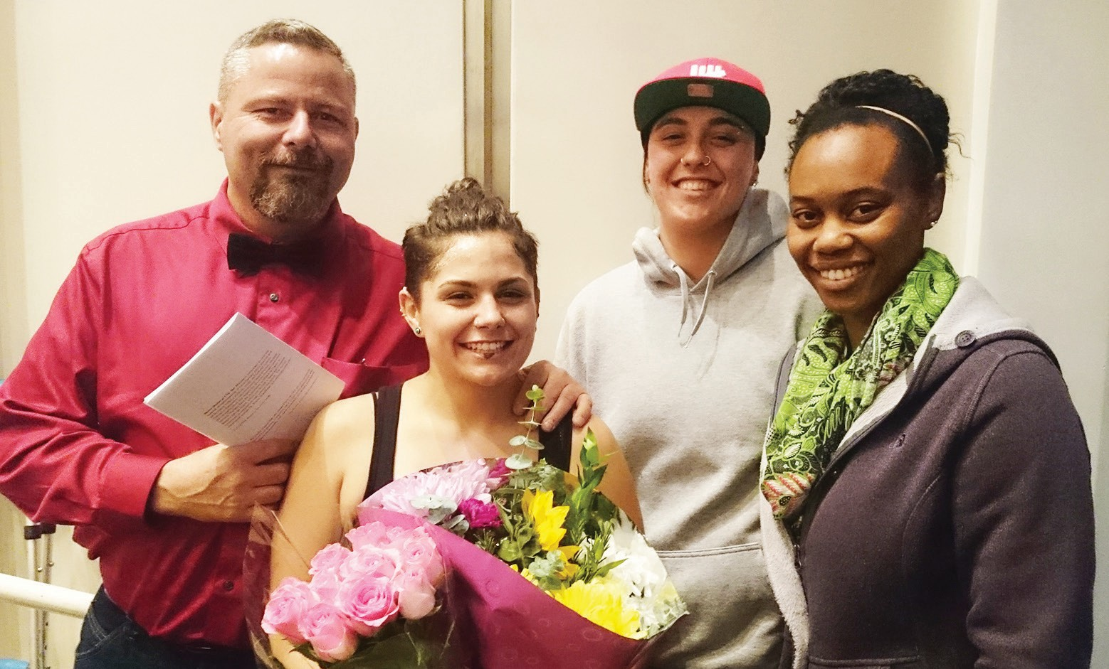 Escondido resident Cierra Potts with her dad and roommates as they show their appreciation for her talents with bouquets of flowers.
