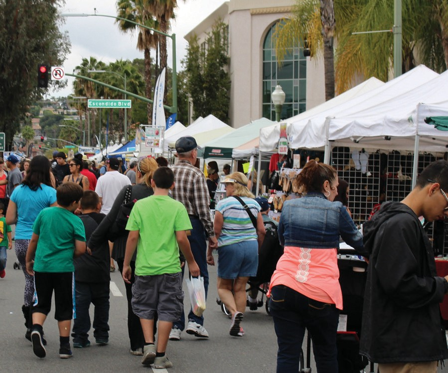 Sunday's Grand Avenue Street Fair attracted thousands of people. See more photos on pages 2 and 7.