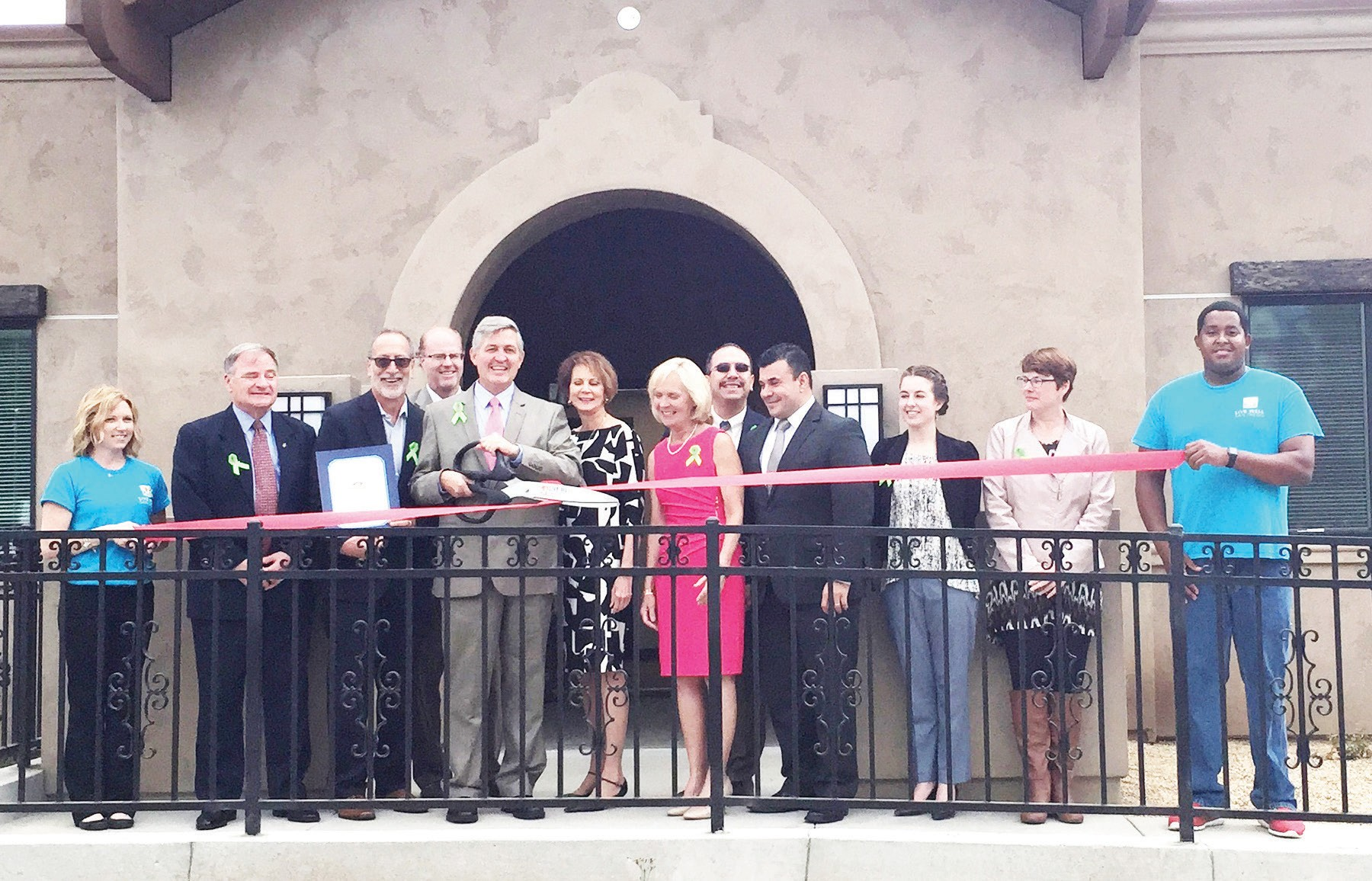 County VIPS, including 3rd District Supervisor Dave Roberts, cut the ribbon Friday morning for the North Inland Crisis Residential Facility.