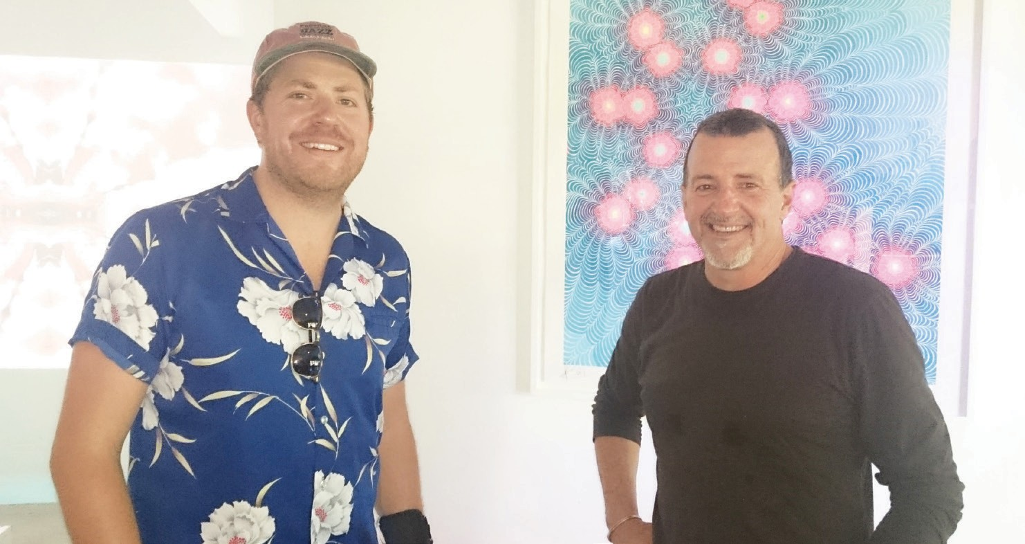 RJ Brooks, co-founder/executive director (left) and Drei Kiel, preparator and working support for the interactive exhibits, enjoying the success of the grand re-opening.