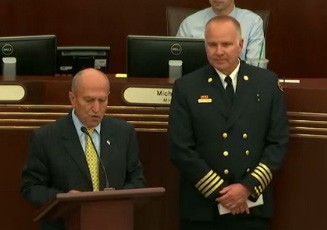 On June 15 Mayor Sam Abed (left) installed new Fire Chief Russ Knowles.