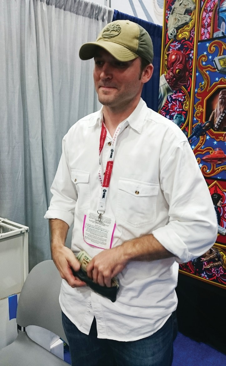 Robert Burden greeting ComiCon pass-holders at his artist booth (2014). Photo by Anne S. Hall.