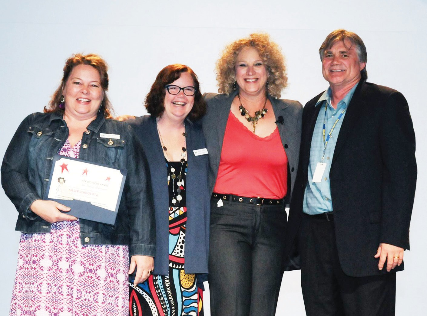 Miller Elementary PTA receives Spotlight Award at Annual California PTA Convention. From left to right: Kathleen Jones, art docent; Denae Senise, art docent; Justine Fisher, California PTA presi­dent; Marty Hranek, principal.