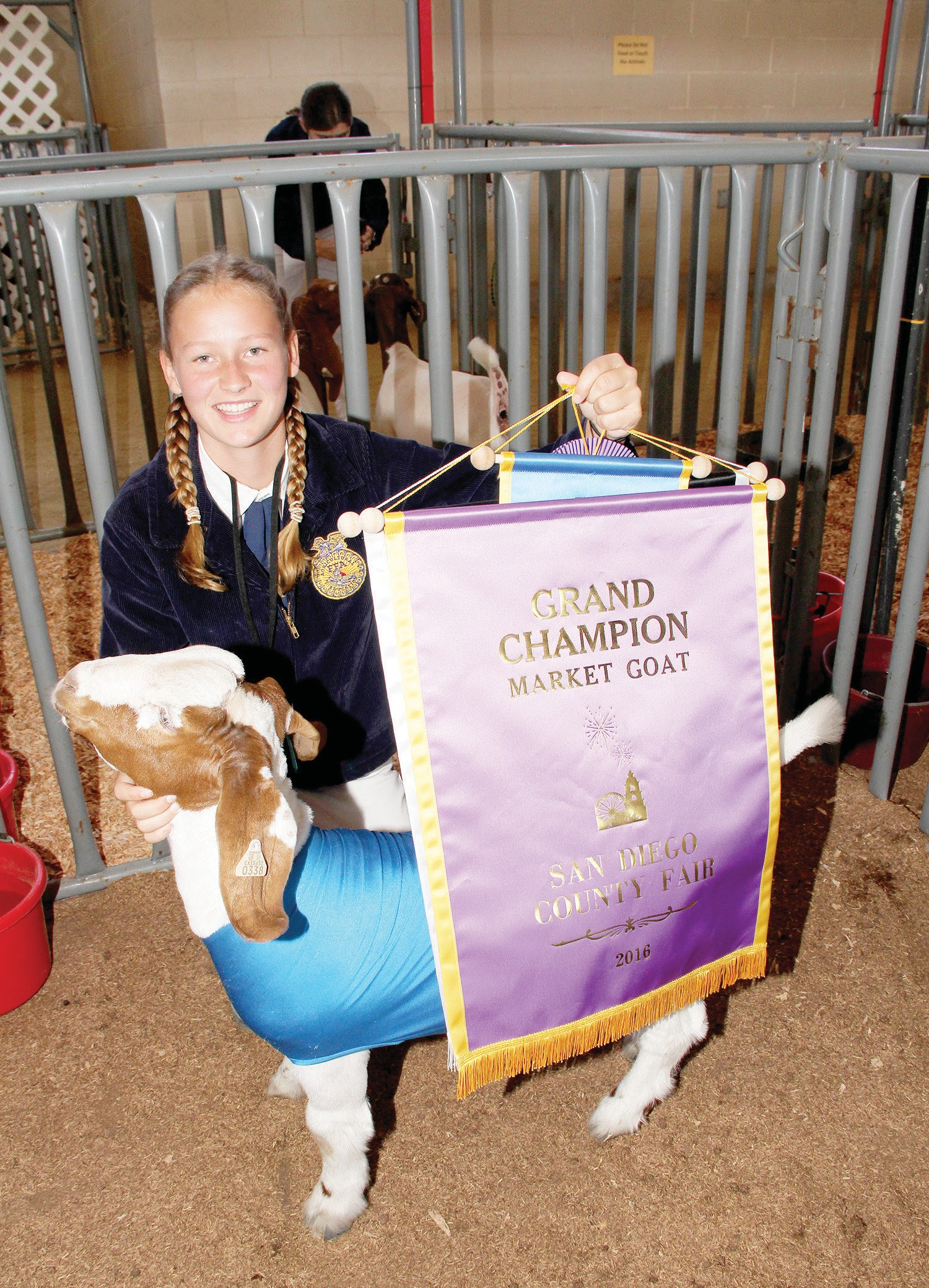 Multiple award winner Samantha Christiansen, age 14, of Escondido FFA with her goat Jet. She won several awards including Grand Champion Market Goat. She has previously entered pigs in the auction but said that this was her first experience with and goat and that it was such an awesome experience she would definitely do this again.