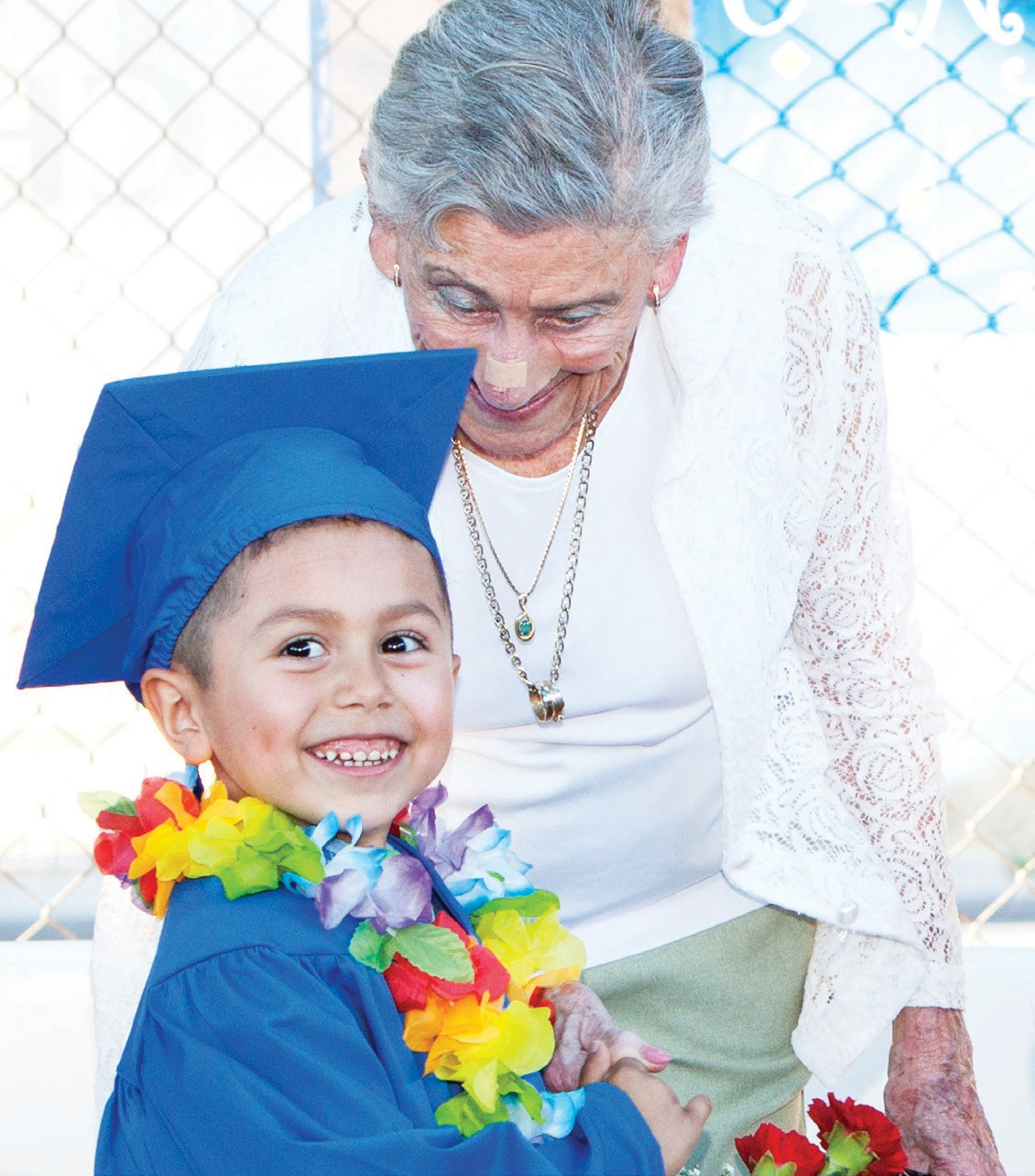 ECCDC preschool graduate Abraham Gonzalez is all smiles as he received congratulations from ECCDC founder Lorraine Boyce. Gonzalez was part of the ceremony to graduate 84 preschool students who will be attending kindergarten in the fall. Lorraine Boyce started the preschool 42 years ago.
