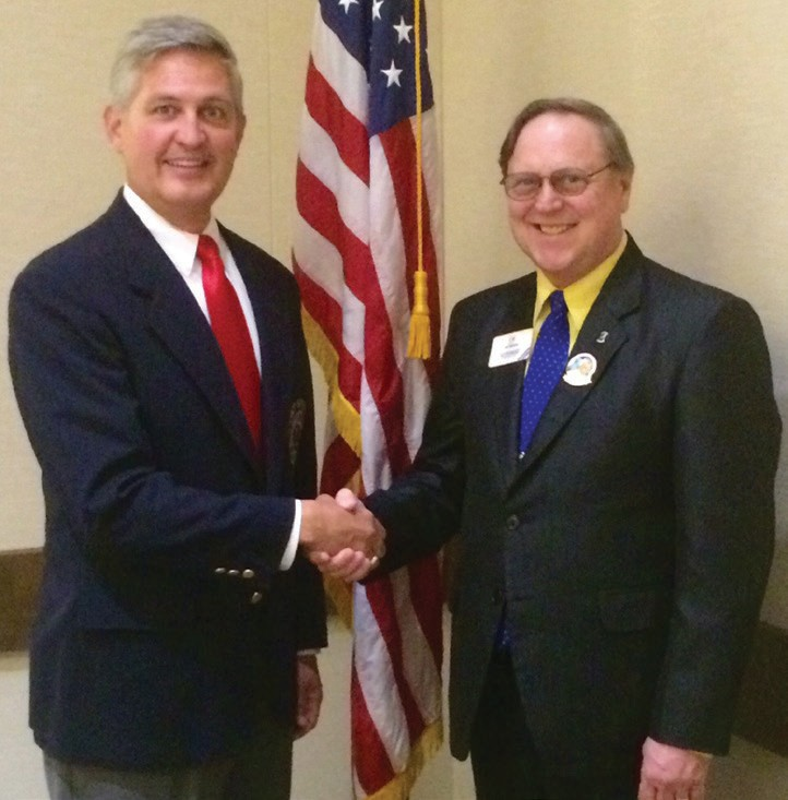 Dave Roberts (left) is installed as new Lions Southern California District Governor by International Past President Joe Preston.