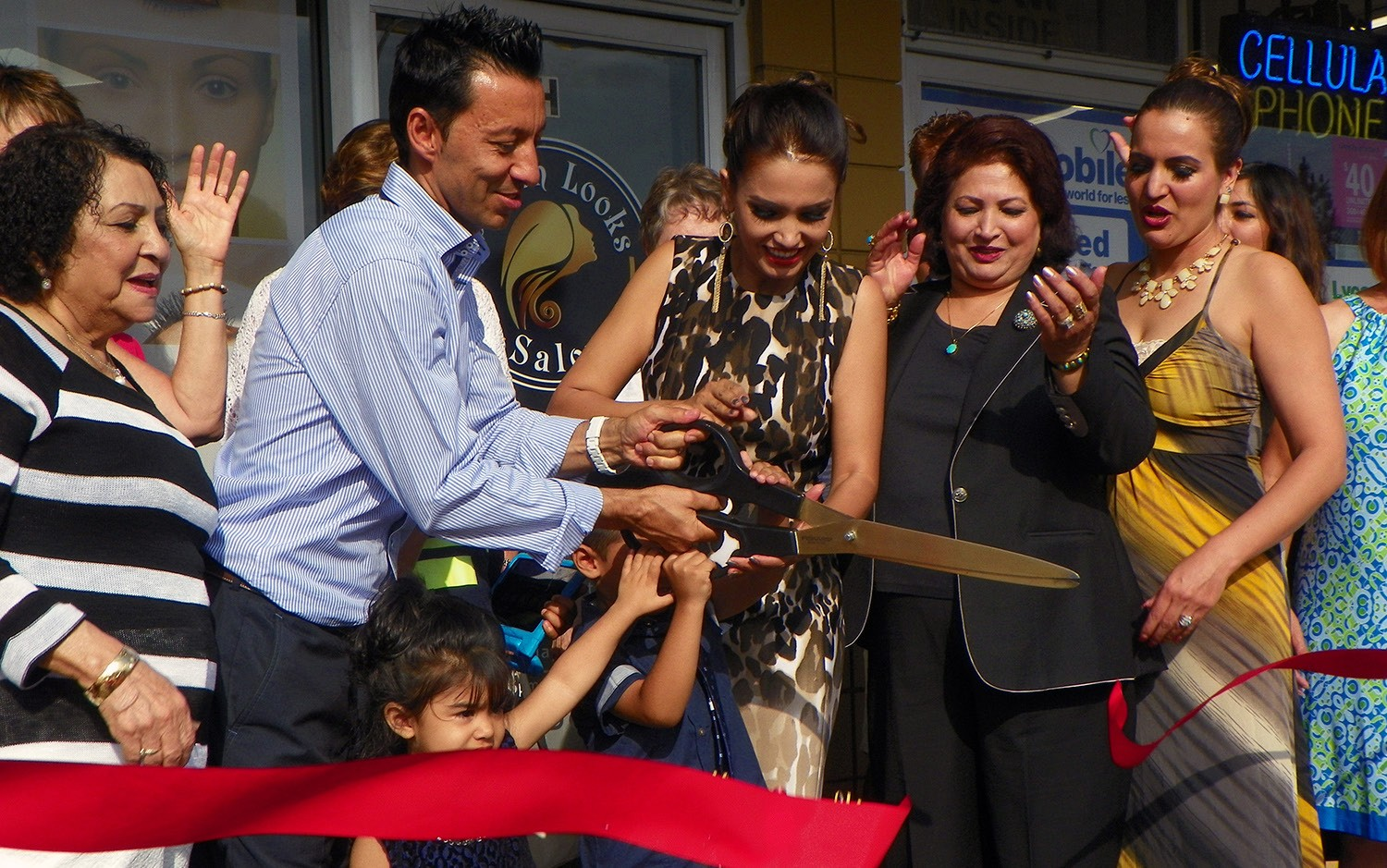 The Golden Looks Salon, a new business in Escondido, celebrated its ribbon cutting on Saturday. Owners Terra & Naim Arzo cut the ribbon. Photo by Kathy MacKenzie