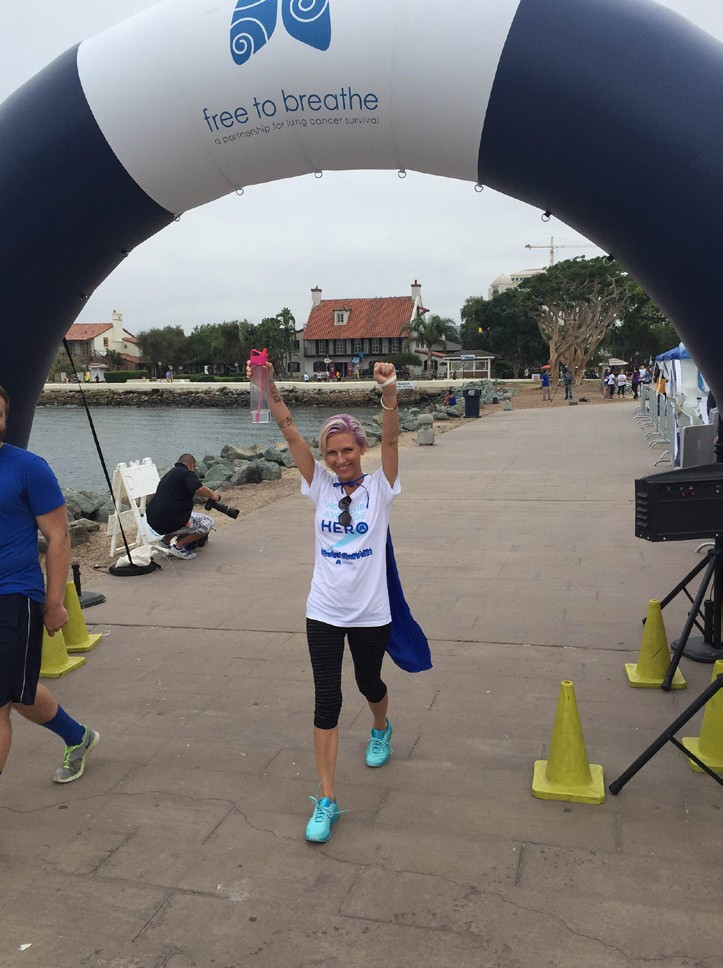 Denette Tanksley exults as she concludes her 5k walk in Sunday's San Diego Free to Breathe event.