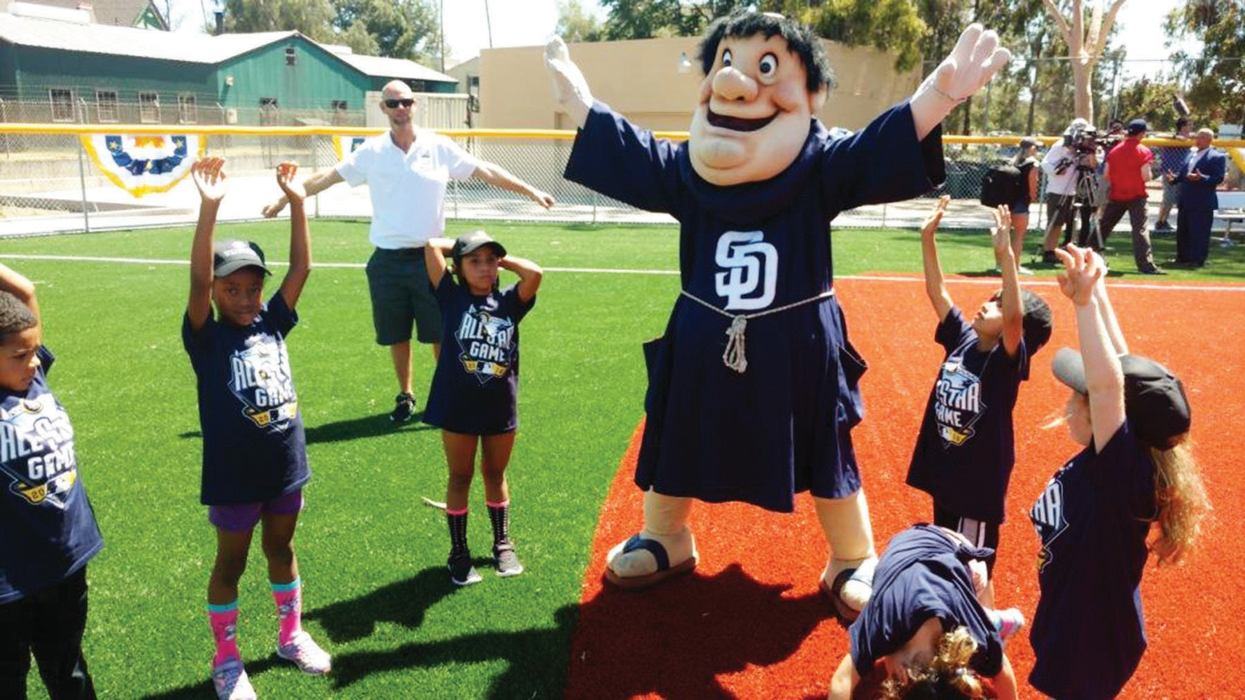 The Padres mascot leads some Boys & Girls Club members in calisthenics.