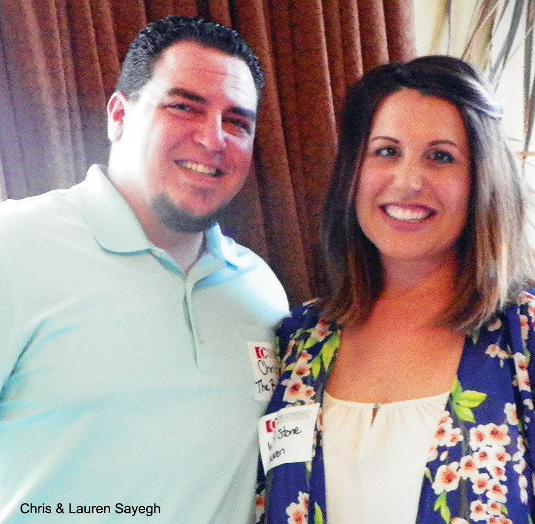 Chris Sayegh, Realtor with The Broker Network chats with his wife, represent­ing W.A. Stone Termite & Pest Control.