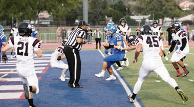 Quarterback Blaine Bailey scores OG's first touchdown on a keeper. Photos by Lenny Kerbs