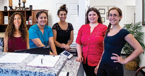 Above: Left to right. Susie-Acupuncturist, Selen - Front office Assistant, Hannah- Massage therapist, Dr. Rosanna Perez (ME) Rebecca- Massage therapist.