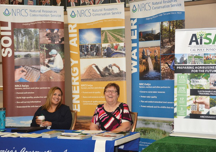 Cori Calvert, District Conservationist and Joyce Stone, Farm Bill Assistant at the NRCS informational booth.
