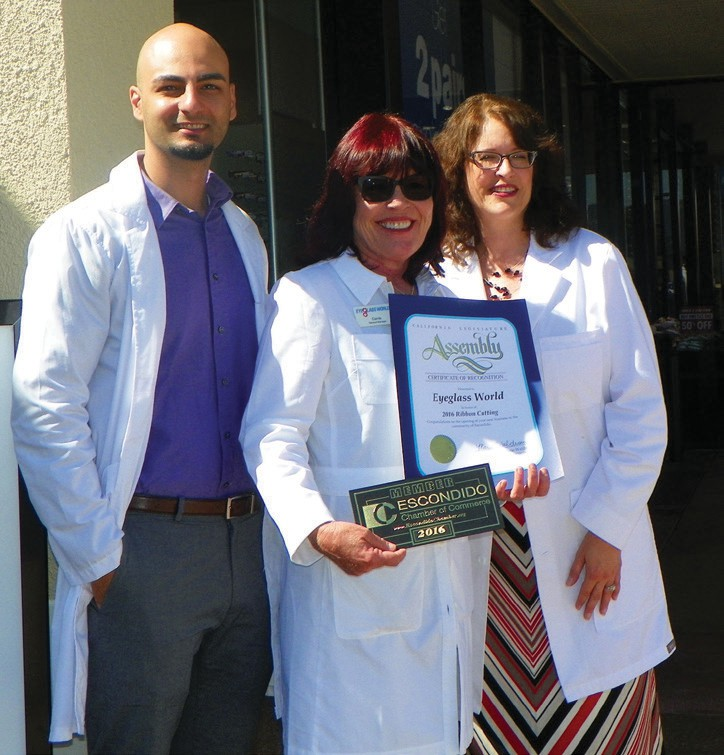 The management of Escondido's Eyeglass World proudly display their new Chamber of Commerce membership plaque.