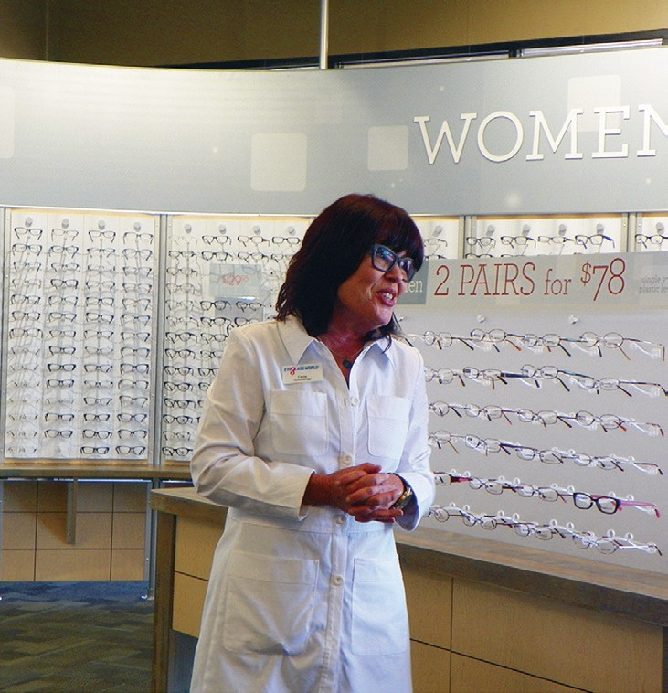 General Manager, Carrie Villalva, explains to the group what Eyeglass World offers.
