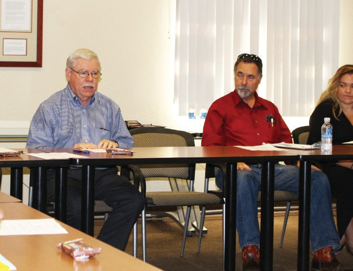 Ernie Cowan, left, chairs the Chamber's Economic Development committee, which hosted the presentation.