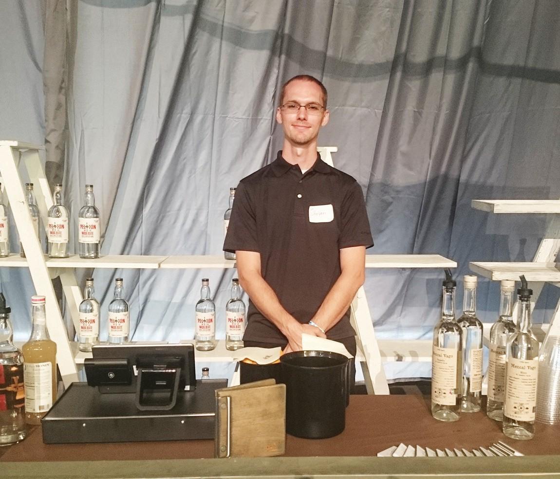 Volunteer, Steven, serving as one of the bartenders for the Mezcal lounge.