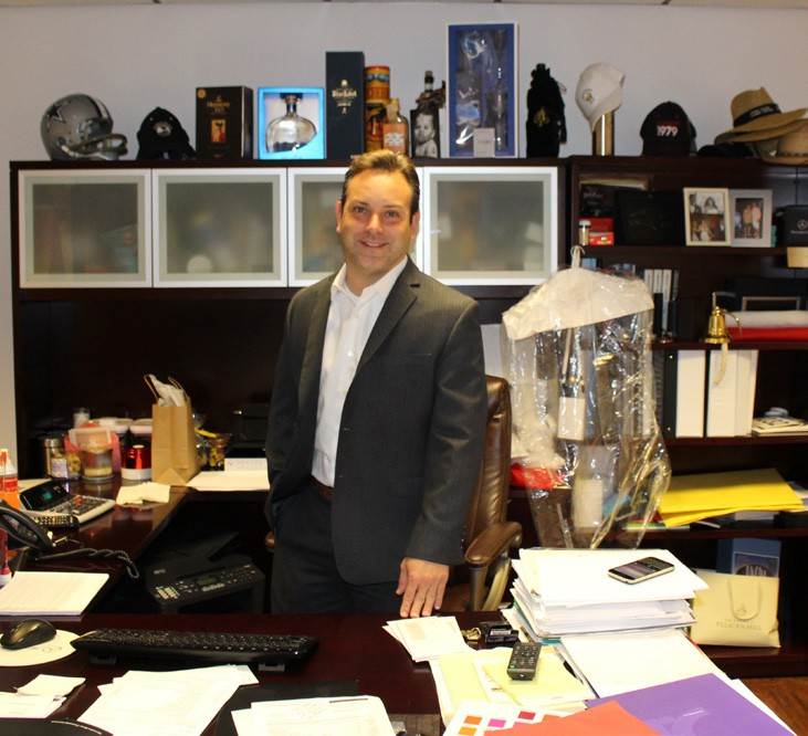 Jason Cestaro, general manager of Mercedes Benz of Escondido in his office, where he rarely spends much time.