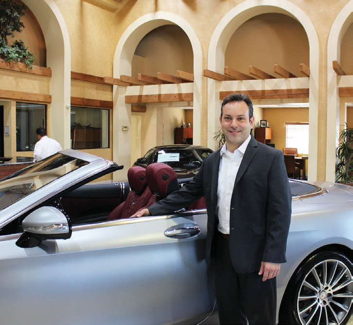Jason Cestaro with one of the luxurious new Mercedes Benz automobiles in the Escondido showroom.