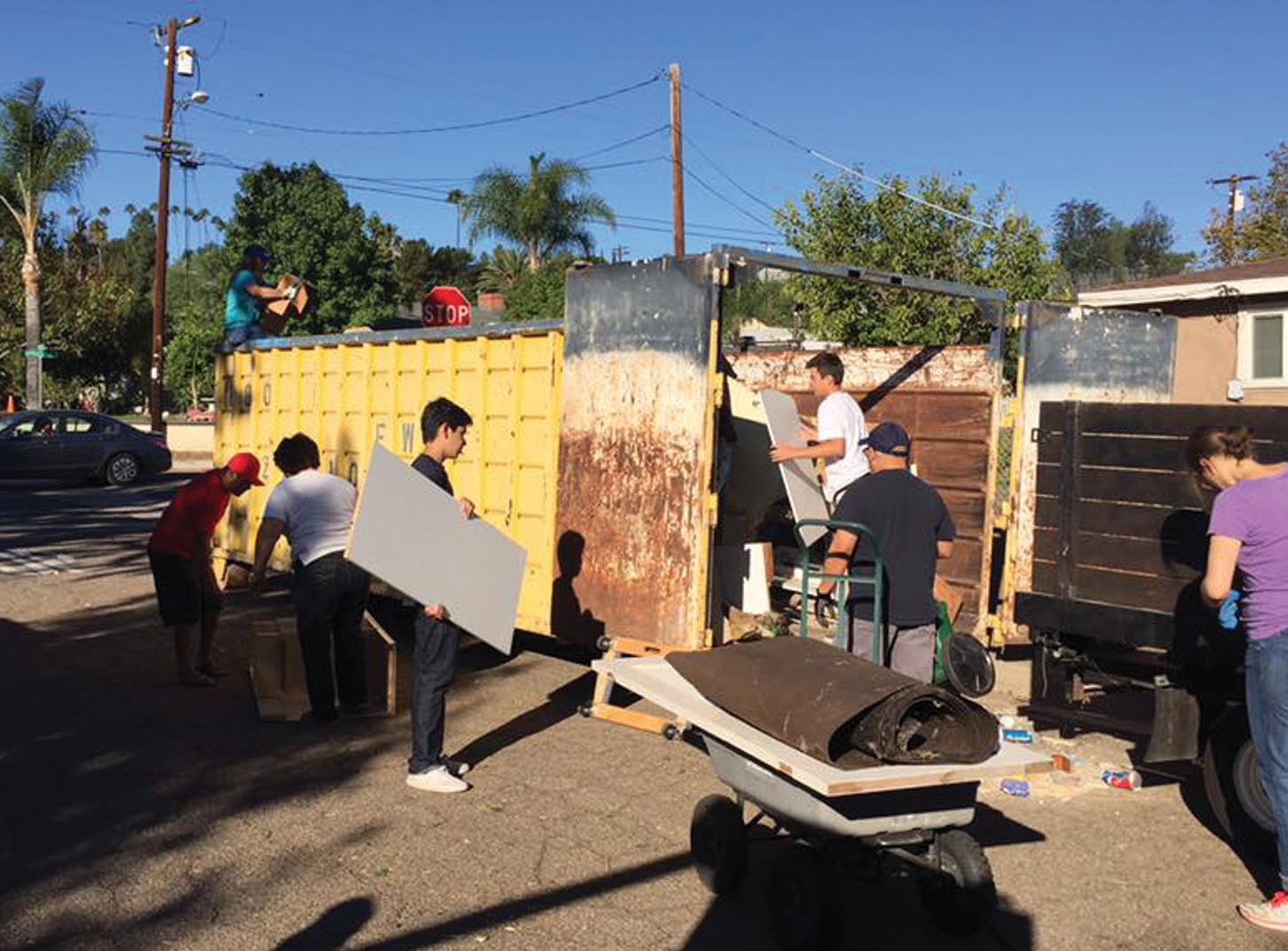Volunteers loading up dumpsters in one neighborhood on the West Side; photo courtesy of Pastor Dave Hall of Emmanuel Faith Community Church