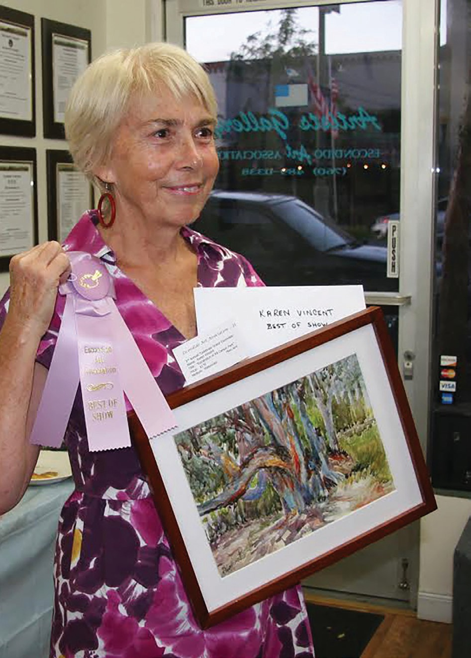 "Best of Show recipient Karen Vincent for her watercolor entitled ""Eucalyptus at Kit Carson Park."" EAA President, Byron Marler made the presentation."