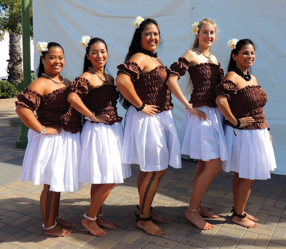 "Kuhai Halau SD Instructor ""Kelly Haupu"" with some of her students."