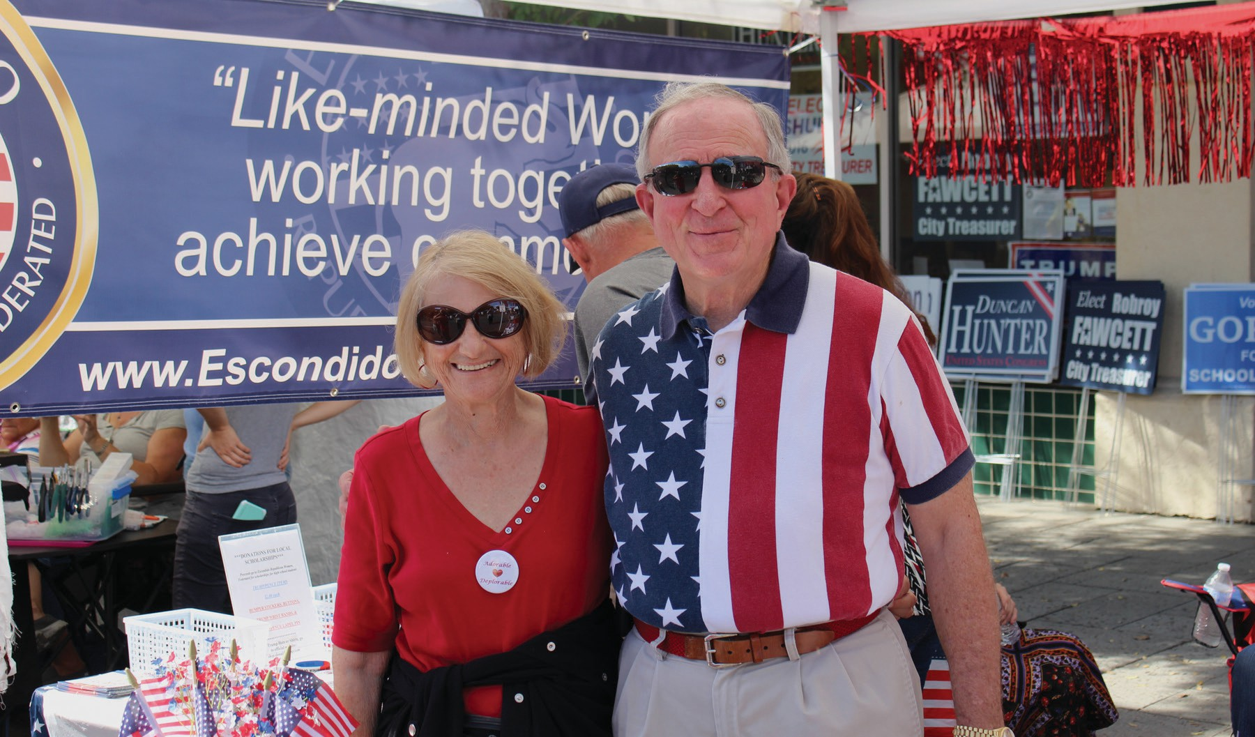 Dr. Doug Moir (see front page story) and his wife, whose name we didn't get, at the Republican booth.