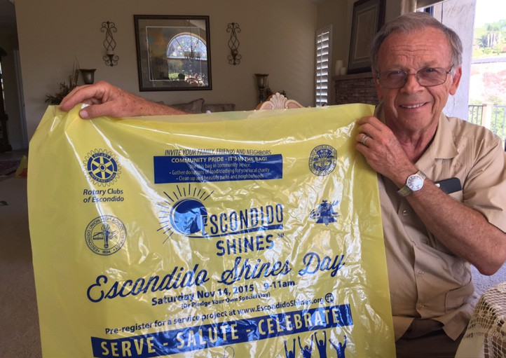 """Vaughn North proudly displays the """"Escondido Shines"""" bag that he would like to see in every nook and corner of Escondido, wherever good works, especially of the civic virtue kind, are being performed."""
