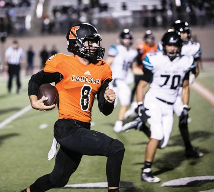 Cougar quarterback Kellen McCoy not only threw well but he was quite effective when forced to scramble. Photos by Lenny Kerbs of Kerbs Custom Photography