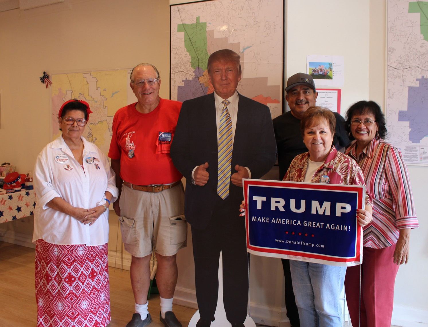 Volunteers at the GOP Escondido headquarters pose with the party's nominee, who, miraculously managed to drop by for a visit just as we showed up for a photo. The candidate ended up being less multidimensional than we had been led to believe.