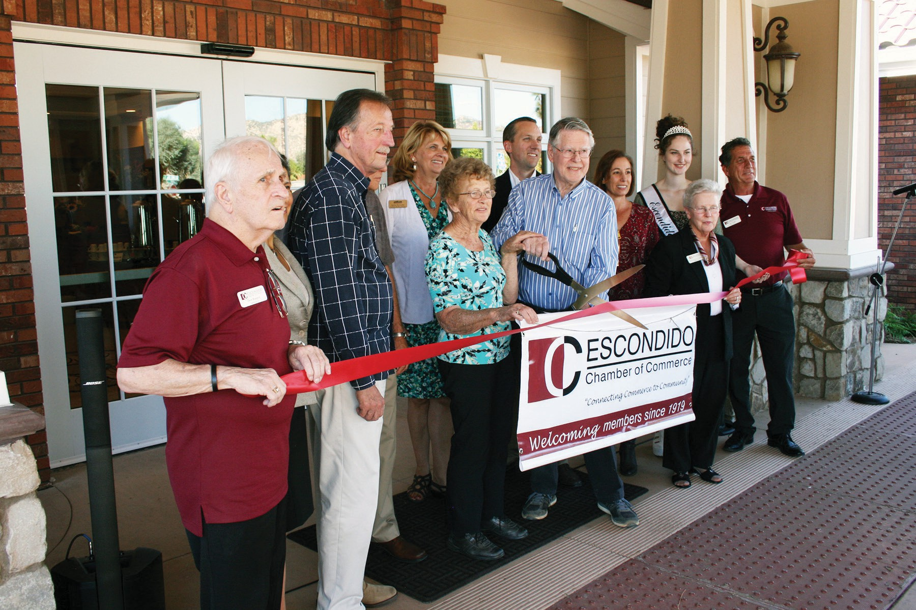 The ribbon cutting group (from left): Don Burgett, Rosa Ruiz, Ed Gallo, Don Smith, Jane and Jack Brouwer, Sylvia Wycinsky, Mark Memmel, Suzanne Southwell, Rorie Johnston, Escondido Princess Amanda Cowie, Joe Coyle.