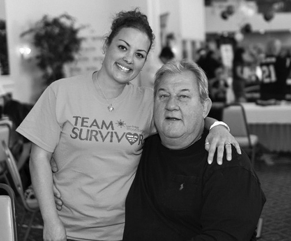 Bree Long at the Chargers Blood Drive in 2014 with NFL alum Louie Kelcher.