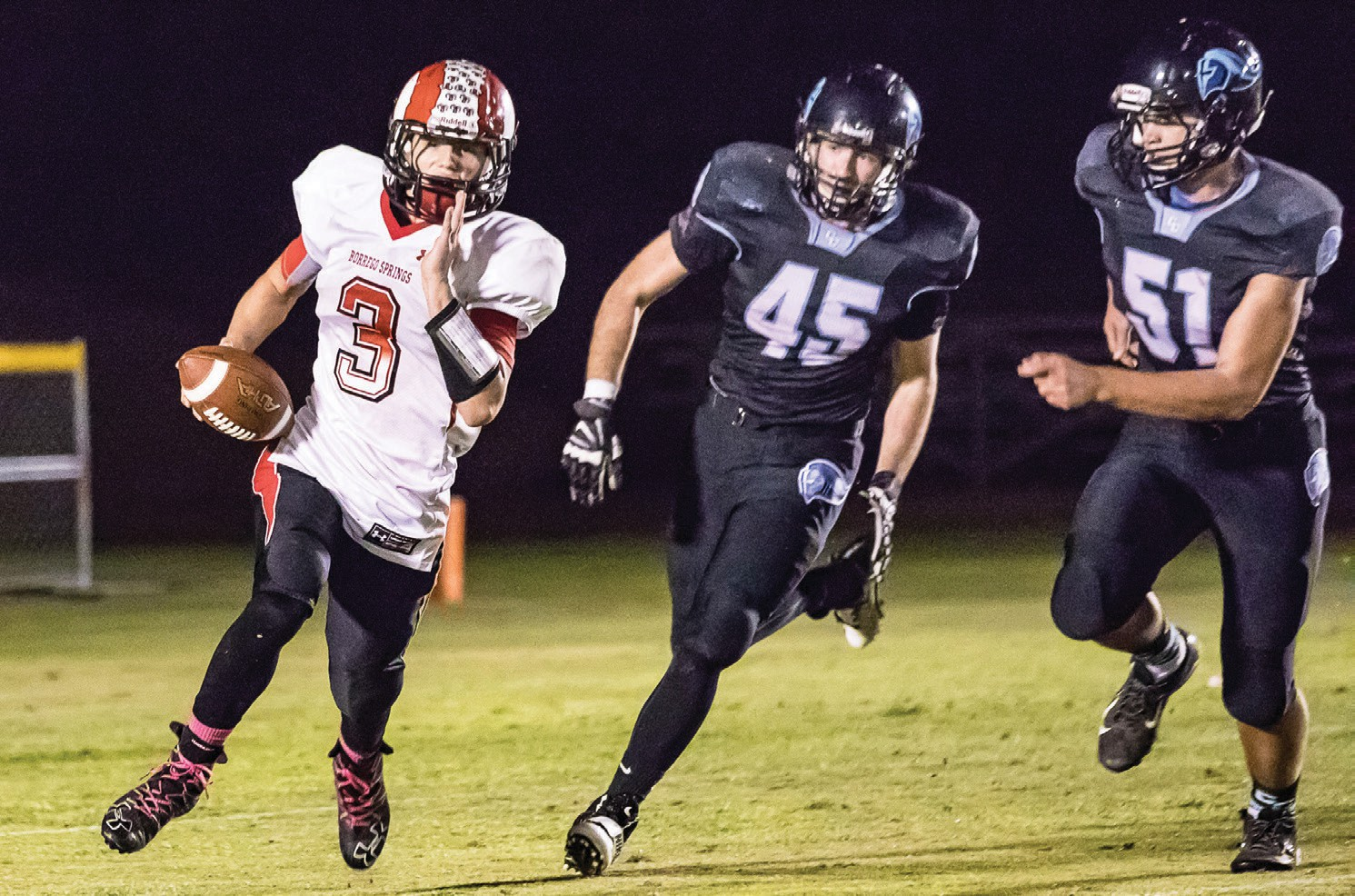Calvin defenders like Mason Crouch (45) and Nico Brower (51) constantly harassed Borrego Springs QB Andrew Morris. Photo by Lenny Kerbs