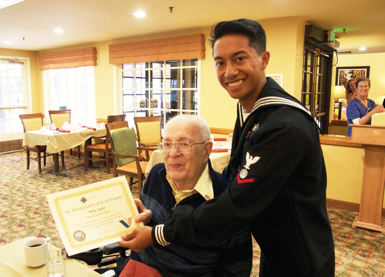 Mike Japko, Navy veteran, is presented with a certificate of appreciation from a Sailor stationed at Camp Pendleton.