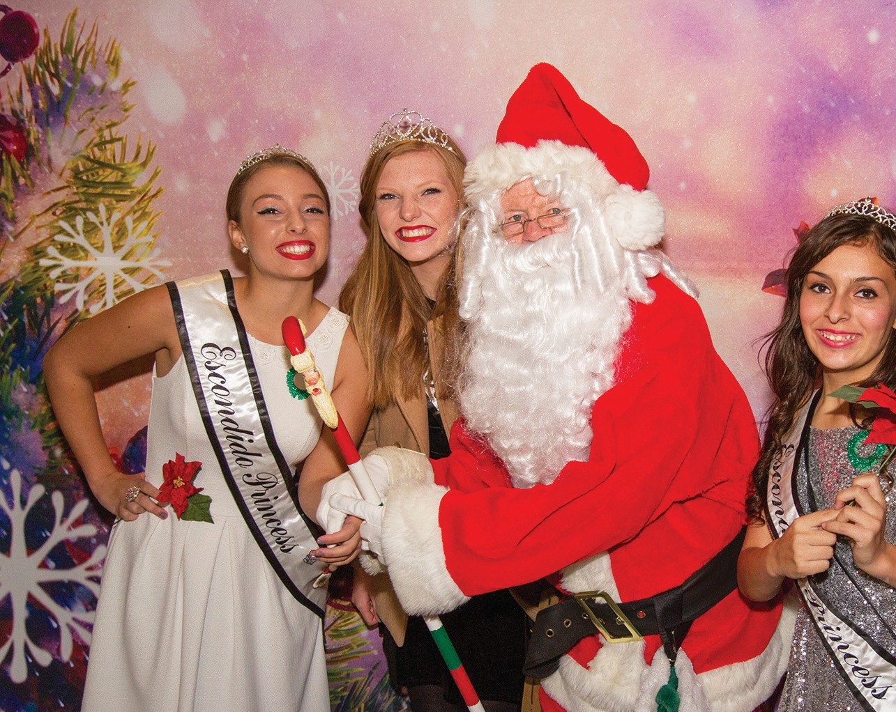 Santa Claus will make an appearance this year. Here he shown last year with his helpers.