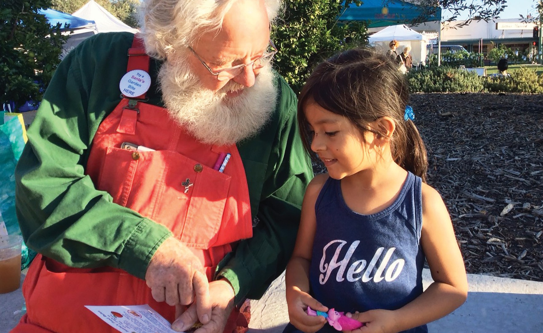 "Santa Glen shows 4-year-old Sofia the value of ""eating the rainbow."""