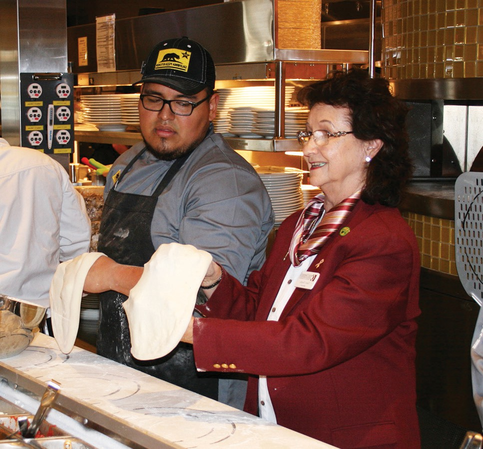 Members of the Escondido Chamber such as Nancy Murphy, were given lessons in how to make a pizza crust.