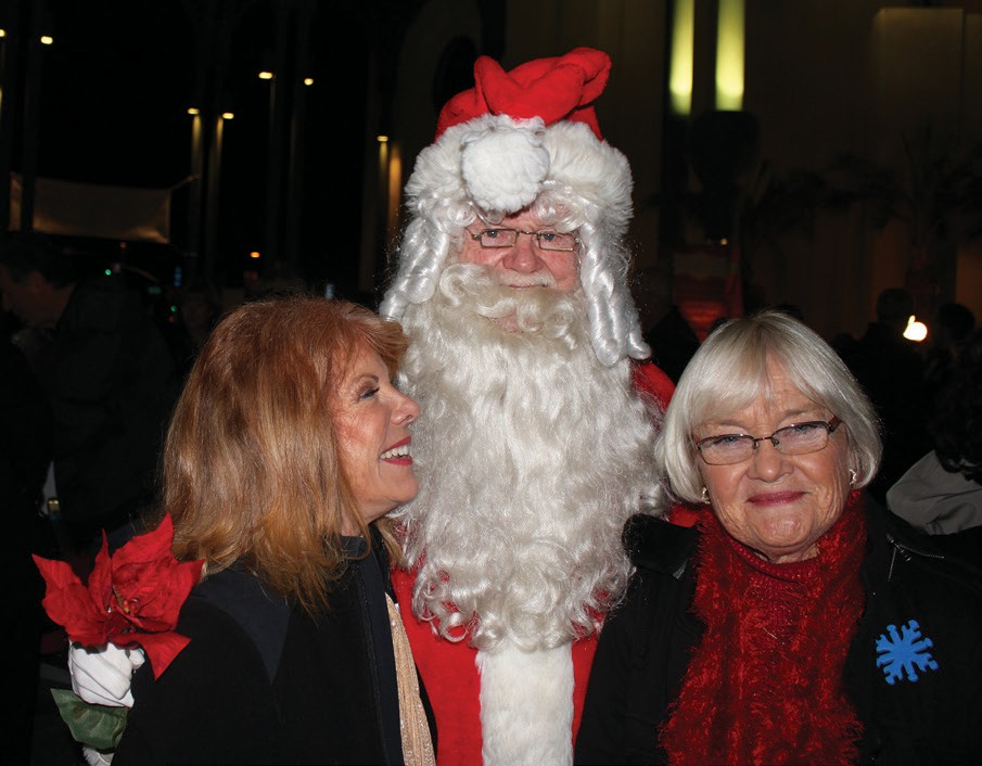 Santa and a couple of admirers tell him what they want for Christmas.