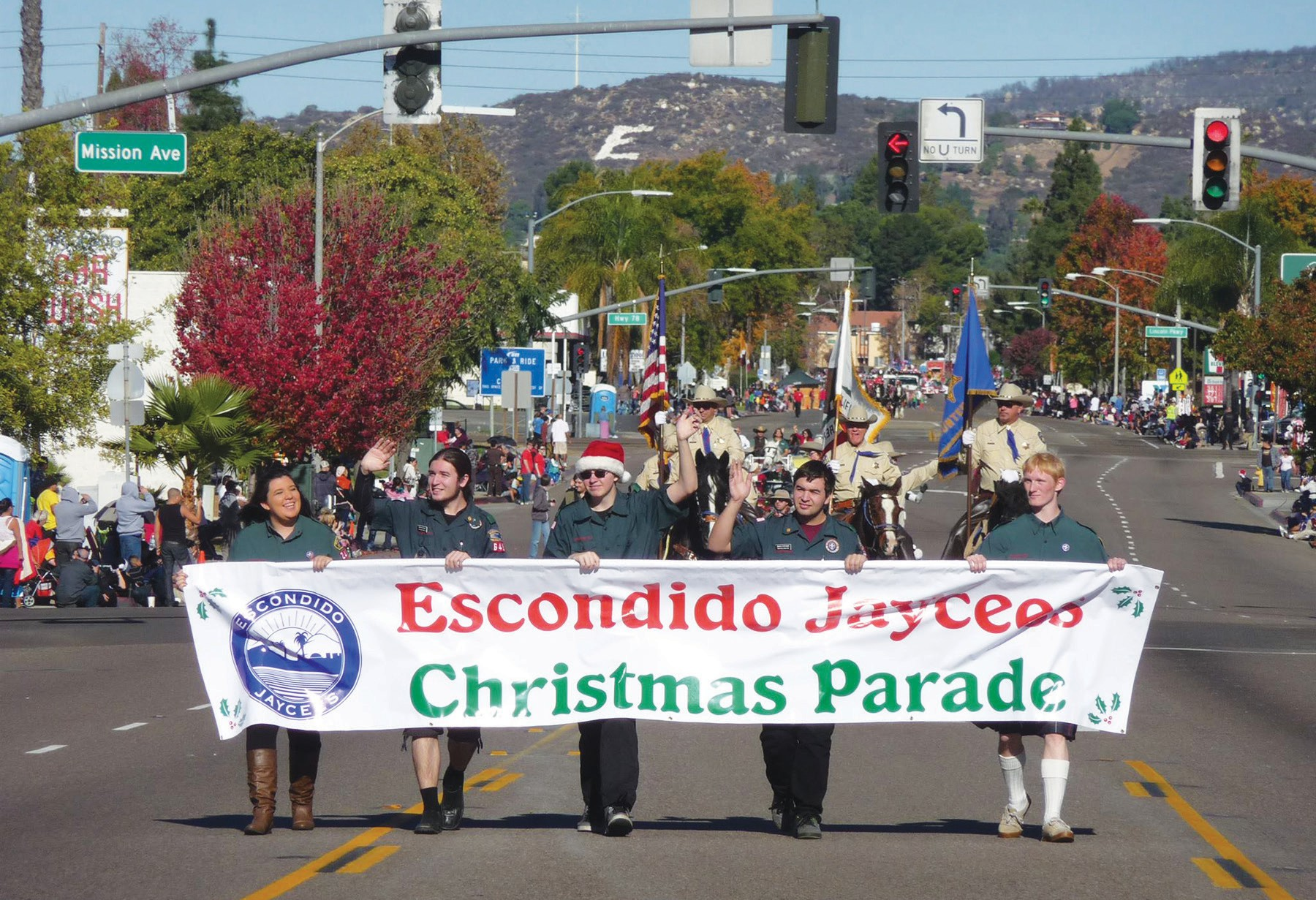 """Last year's parade leads off. It goes along Broadway from Escondido High School (you can see the big """"E"""" in the background) to Grape Day Park."""