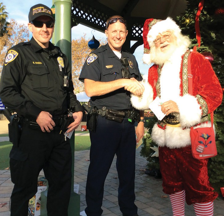Santa gives a recommendation to Escondido police officers about some kids who deserve to be recognized for their good eating habits.