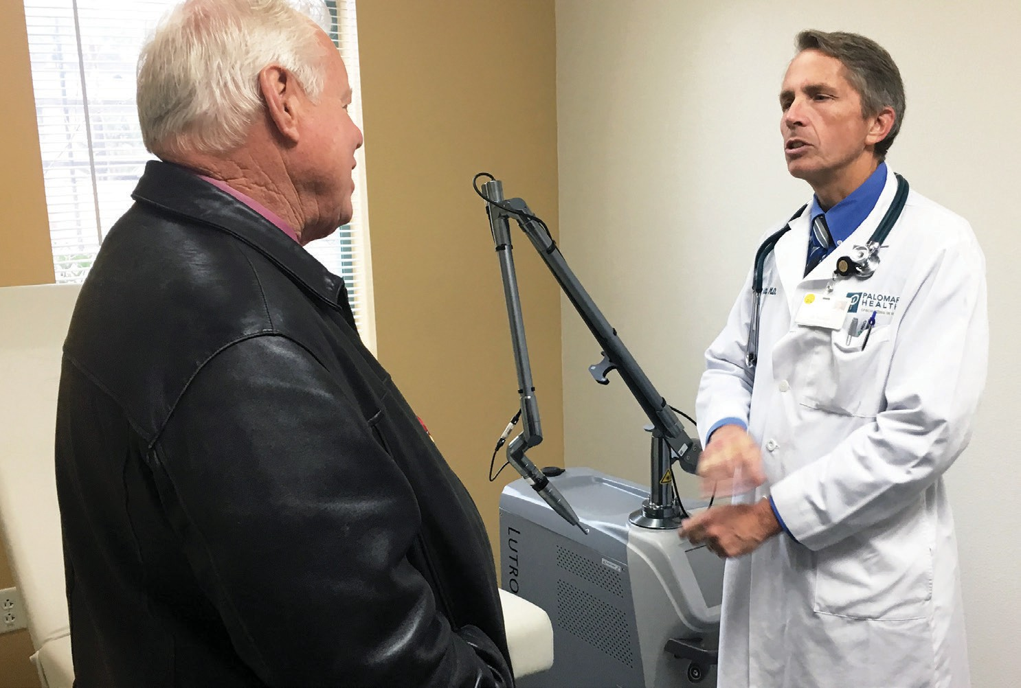 Supervisor Bill Horn speaking with Neighborhood Healthcare Medical Director Dr. James Schultz. Dr. Schultz will be overseeing the actual medical portion of the program and will be performing the gang tattoo removal.