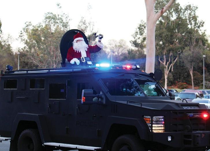 Santa arrives aboard one of Escondido's tactical assault vehicles.