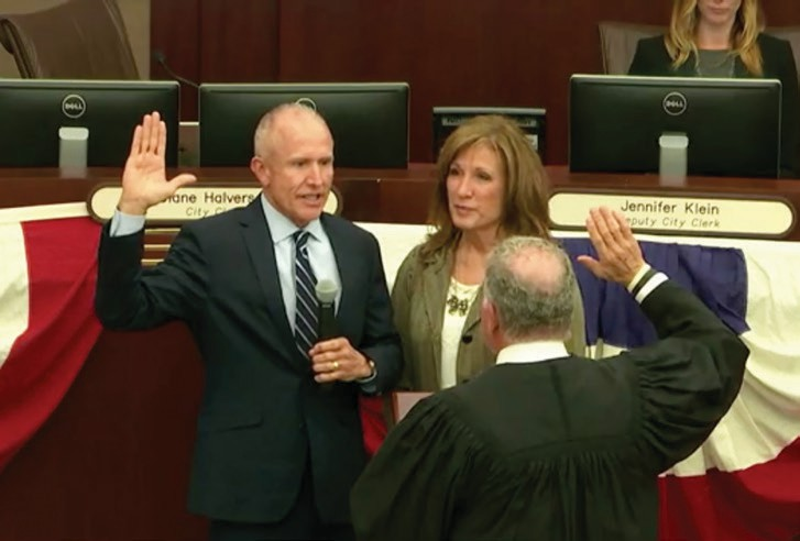 Mike Morasco joined by his wife Jill, takes the oath of office for a second term.