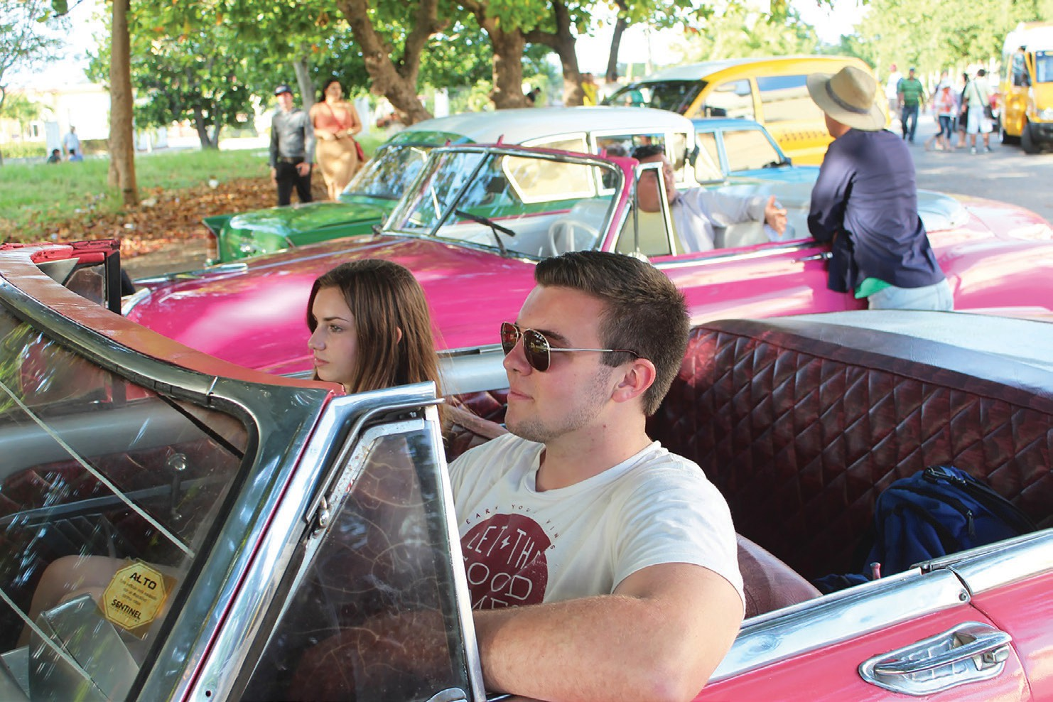 Author's son, Robert, and daughter, JoAnna, enjoying a classic American convertible.