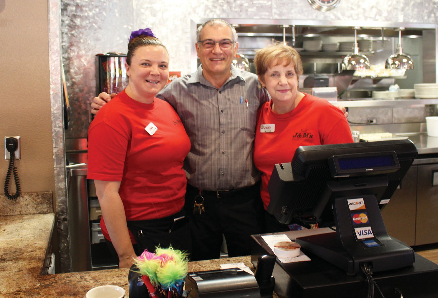 "Joe Goncalves, owner of J&M's Restaurant, has always prided himself on selling ""quality food at an affordable price. He is shown with longtime employees Shannon Jones and Kimberly Forrest."