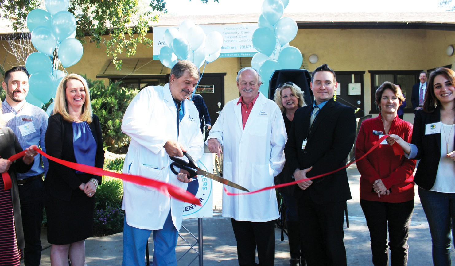 Arch Health CEO Deanna Kyrimis (second from left) watches while Dr. David Greb and Dr. Roy Johnson cut the ribbon to the new office. Shown with them are members of the Valley Center Chamber of Commerce, including (from left) Brandon Strausbaugh, Joshua Sibelius, Dianne Conaway and Julia Boulos. Photos by David Ross