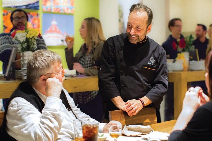 Discussing pairings and flavors with CPK's Executive Chef, Brian Sullivan.
