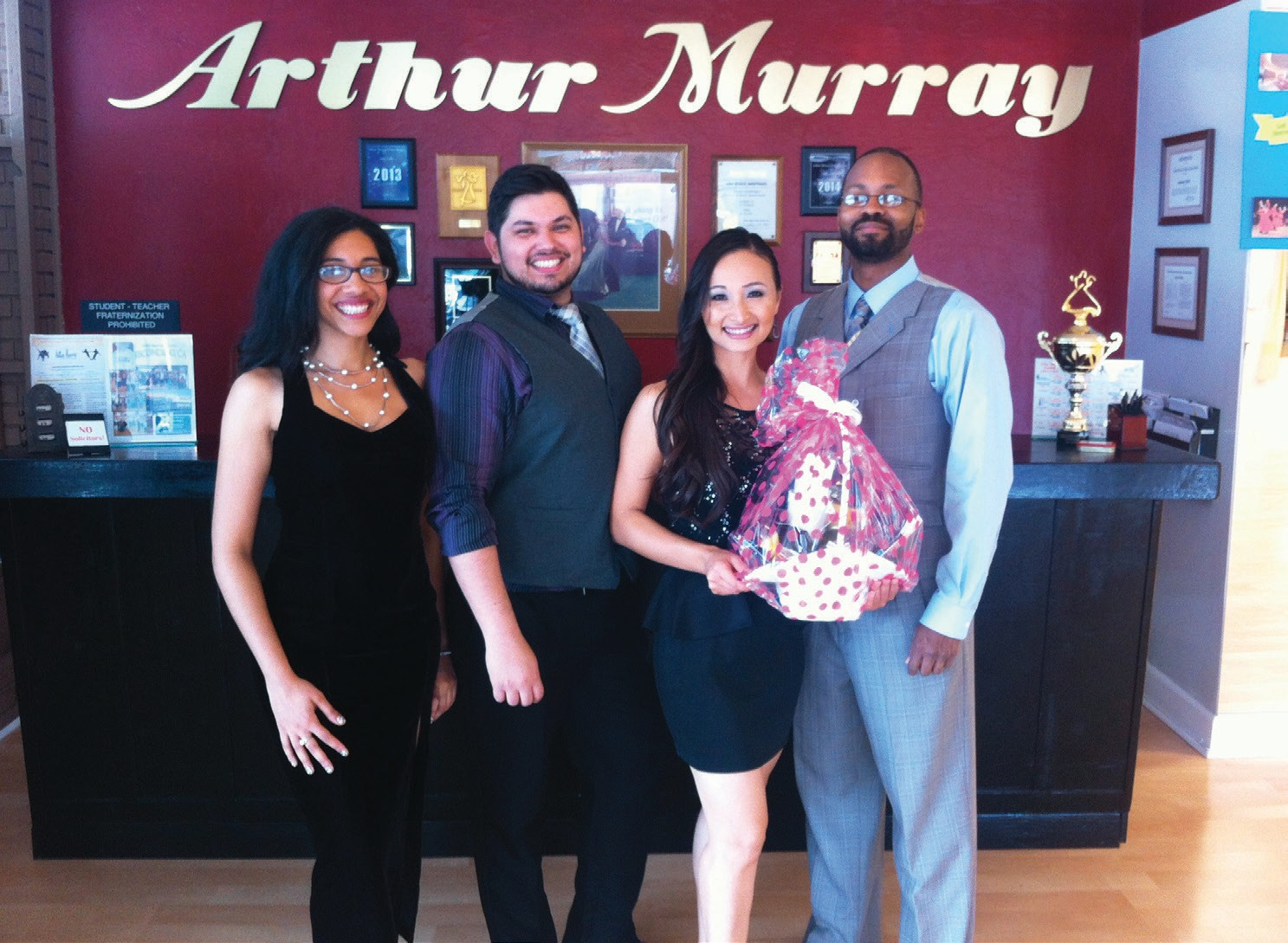 Autumn Dinh, owner of the Escondido Arthur Murray Dance Studio, and her staff of dance teachers, Domonique Dawson, Juan Galindo and Kristen Ortiz.